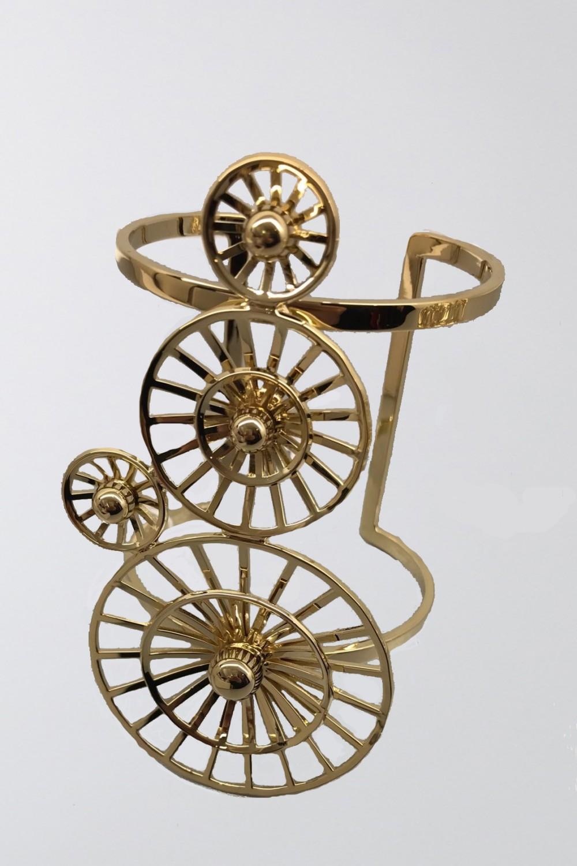 Bracciale cuff maxi oro giallo ingranaggi